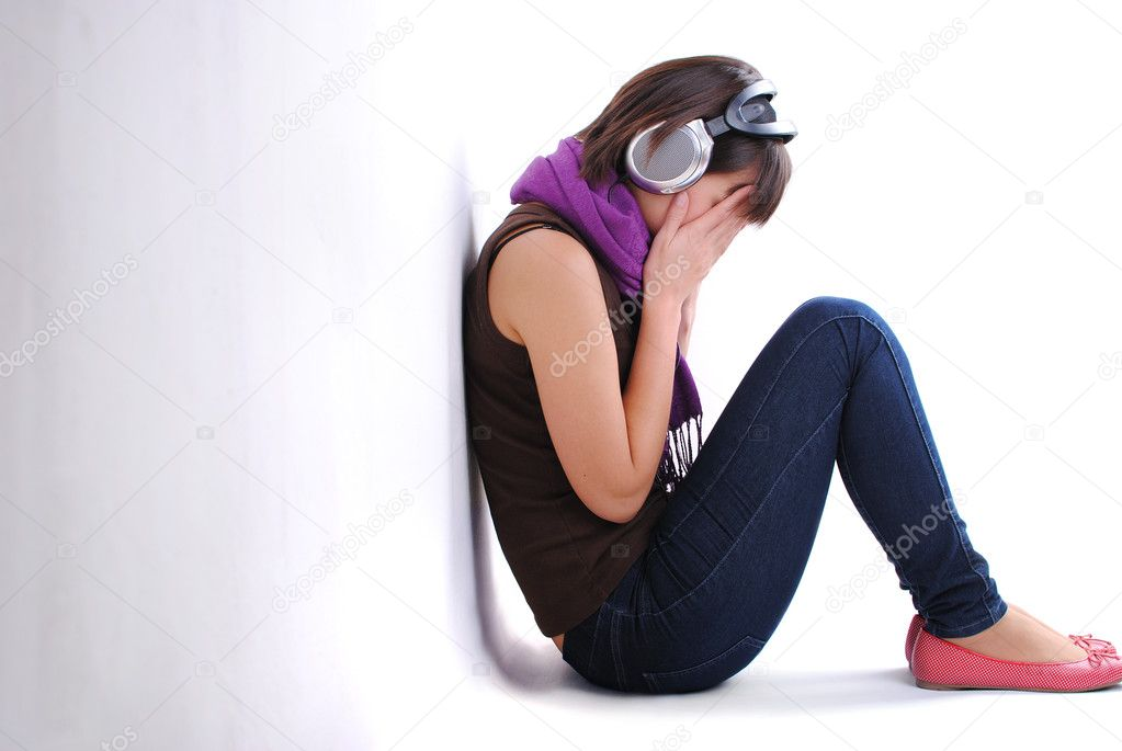 Depression teen girl listening to music and cried lonely in room — Stock Photo #7227670