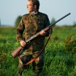 Hunter with rifle gun — Stock Photo #6768627