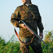 Hunter with rifle gun — Stock Photo #6768635