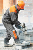 Builder at cutting curb work — Stock Photo