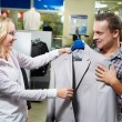 Young couple at clothes shopping — Stock Photo #6850380