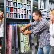 Young couple at clothes shopping — Stock Photo #6850406