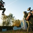 Paintball player under attack — Stock Photo #6905902