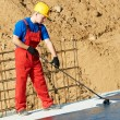 Stock Photo: Builder worker at roof insulation work
