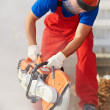 Stock Photo: Builder at cutting curb work