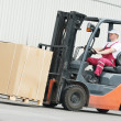 Warehouse worker driver in forklift — Stock Photo
