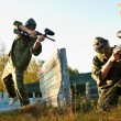 Paintball player under attack — Stock Photo