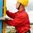 Stock Photo: Builder with level