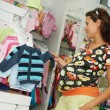 Young pregnant woman at shop — Stock Photo #6938067