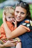 Mother and child in her hands — Stock Photo