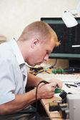 Worker soldering microchip scheme — Stock Photo