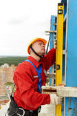 Builder with level — Stock Photo