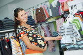 Young pregnant woman at shop — Stock Photo