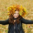 Woman with maple wreath at autumn outdoors — Stock Photo #7103613