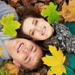 Young couple at autumn outdoors
