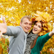 Young couple at autumn outdoors — Stock Photo