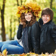 Couple at autumn outdoors — Stock Photo
