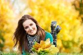 Woman at autumn outdoors — Stock Photo