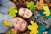 Young couple at autumn outdoors — Foto Stock