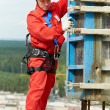 Stock Photo: Worker mounter at construction site