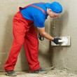 Stock Photo: Plasterer at work