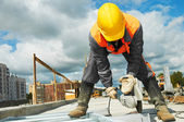 Builder working with cutting grinder — Stock Photo