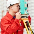 Surveyor works with theodolite — Stock Photo #7141446