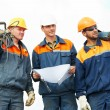 Construction workers with power tools — Stock Photo