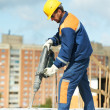 Stock Photo: Portrait of construction worker with perforator