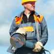 Portrait of construction worker with grinder — Stock Photo