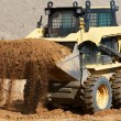 Skid steer loader at earth moving works — Stock Photo #7142198