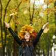 Woman with maple wreath at autumn outdoors — Stock Photo