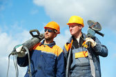 Construction workers with power tools — Stockfoto