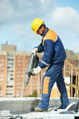 Portrait of construction worker with perforator — Stock Photo