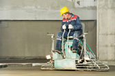 Worker trowelling and finishing of concrete — Stock Photo