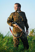 Hunter with rifle gun — Stock Photo
