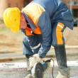 Builder working with cutting grinder — Stock Photo #7235875