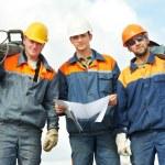 lavoratori edili con elettroutensili — Foto Stock