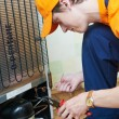 Stock Photo: Repair work on fridge appliance