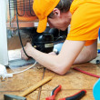 Repair work on fridge appliance — Stock Photo