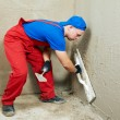 Plasterer at work - Stock Photo