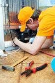 Repair work on fridge appliance — Stock Photo