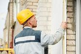 Builder facade plasterer worker — ストック写真