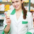 Cheerful pharmacist chemist woman — Stock Photo