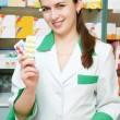 Cheerful pharmacist chemist woman — Stock Photo