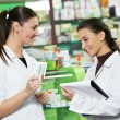 Stock Photo: Pharmacy chemist women in drugstore