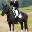 Horsewoman jockey in uniform with horse — Stockfoto