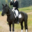 Horsewoman jockey in uniform with horse — ストック写真