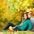 Couple at autumn outdoors — Stock Photo #7324363