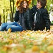 Foto Stock: Couple at autumn outdoors